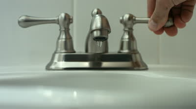 stock-footage-turning-on-faucet-slow-motion